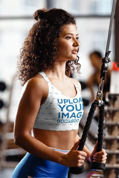 Sublimated Sports Bra Mockup of a Curly-Haired Woman Working Out at the Gym 35277-r-el2