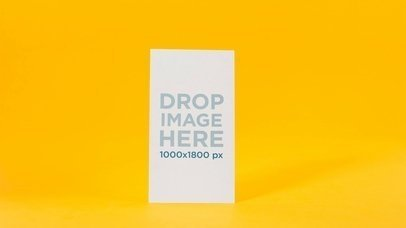 Mockup Of A Flyer Standing On A Yellow Environment While Its Shadow Moves Stop Motion a13732