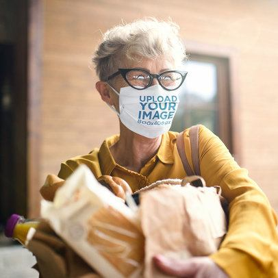 Face Mask Mockup of a Senior Woman Carrying Groceries 40554-r-el2