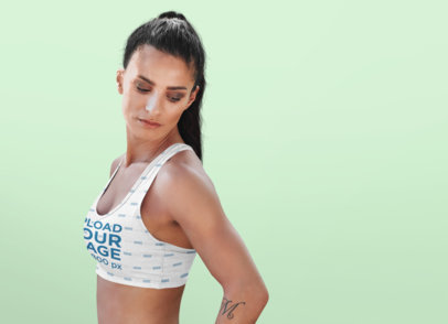 Studio Mockup of a Fit Woman Wearing a Sublimated Sports Bra 34989-r-el2