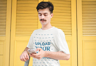T-Shirt Mockup of a Man with a Mustache Checking His Phone 39880-r-el2