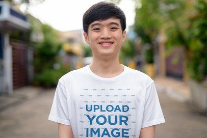 T-Shirt Mockup Featuring a Smiling Teenage Boy 40312-r-el2