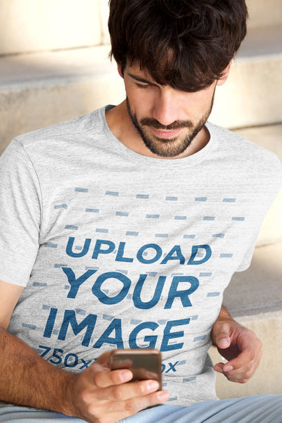 Heather T-Shirt Mockup Featuring a Bearded Man Checking His Phone 37570-r-el2