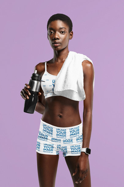 Sports Bra and Bike Shorts Mockup of a Serious Woman Posing Against a Plain Backdrop 41171-r-el2