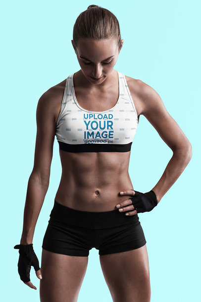 Sports Bra Mockup Featuring an Athletic Woman in a Studio 35575-r-el2