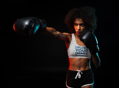 Sports Bra Mockup of a Woman Boxing in a Dark Room 37826-r-el2