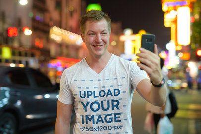 V-Neck T-Shirt Mockup of a Man Taking a Selfie on the Street 40111-r-el2