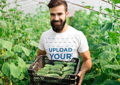 T-Shirt Mockup Featuring a Man Carrying a Box of Cucumbers 40660-r-el2