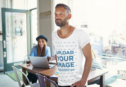 T-Shirt Mockup of a Man in a Casual Workplace 37602-r-el2