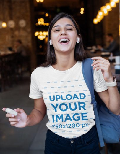 T-Shirt Mockup Featuring a Female Student Laughing 40728-r-el2