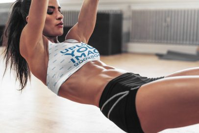 Activewear Mockup of a Woman Wearing a Sublimated Sports Bra While Exercising 34988-r-el2