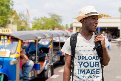 T-Shirt Mockup of a Man Doing a Tour Through a City 40090-r-el2