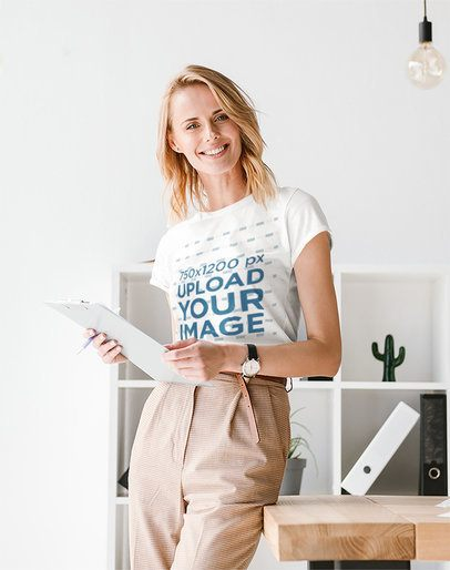 T-Shirt Mockup Featuring a Woman Posing at a Minimalist Office 37658-r-el2
