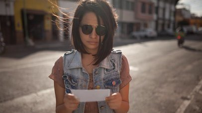 Mockup Stop Motion Of A Young Trendy Girl Showing You A Flyer While At The Street a13739