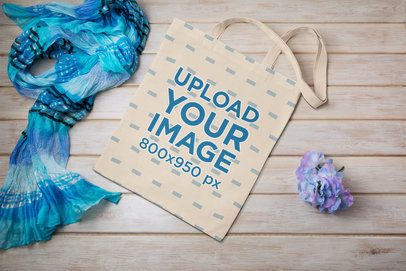 Mockup of a Tote Bag Placed Next to a Decoration Flower 41540-r-el2