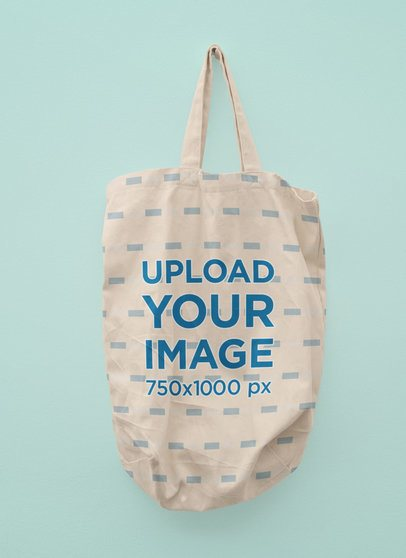Mockup of a Sublimated Tote Bag Hanging Against a Customizable Background 41742-r-el2