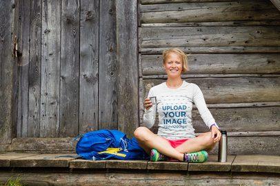 Long Sleeve Tee Mockup of a Female Hiker Sitting Outside a Cabin 42087-r-el2