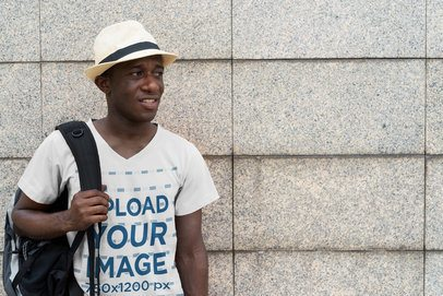 Mockup of a Tourist Wearing a V-Neck Tee on the Street 40410-r-el2