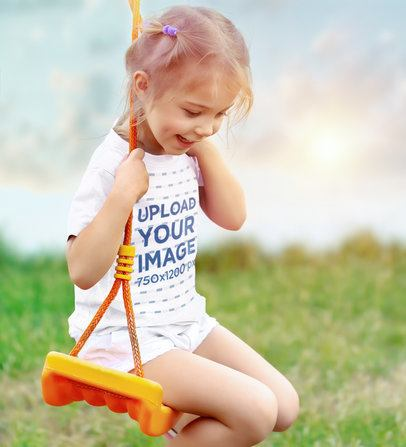 T-Shirt Mockup of a Smiling Girl on the Swings 41892-r-el2
