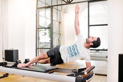 T-Shirt Mockup of a Man Doing a Side Plank on a Machine 38673-r-el2