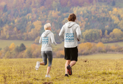 Heather Hoodie Mockup of a Man and a Woman Running at the Outdoors 40907-r-el2
