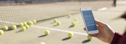 Girl Holding An iPhone While At A Tennis Court Mockup a14092wide