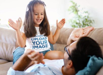 T-Shirt Mockup of a Girl Playing With Her Father on a Couch 41910-r-el2