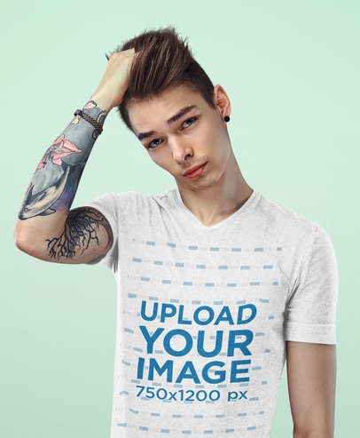 Mockup of a Tattooed Young Man Wearing a Heather V-Neck T-Shirt 38216-r-el2