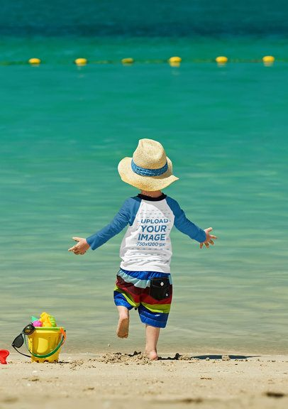 Back View Mockup of a Little Boy with a Raglan Long-Sleeve Tee Playing in the Beach 42112-r-el2