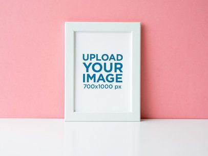 Mockup of an Art Print Leaning on a Pink Wall 36064-r-el2