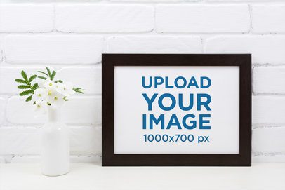 Mockup of a Horizontal Art Print Placed by a Flower Vase 37135-r-el2
