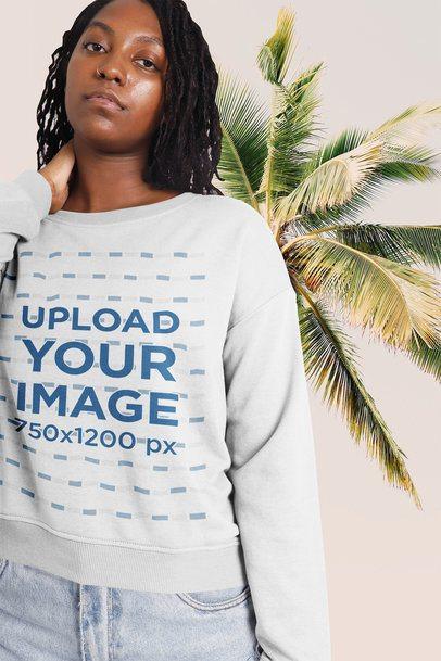 Sweatshirt Mockup of a Woman Posing Near a Palm Tree 42555