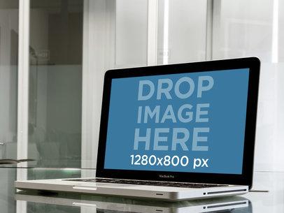 MacBook Pro Over Glass Desk In Business Room