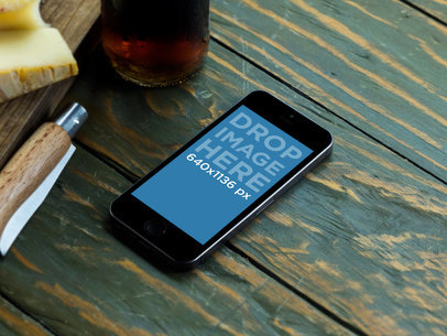 iPhone 5s Space Grey On Green Wooden Restaurant Table