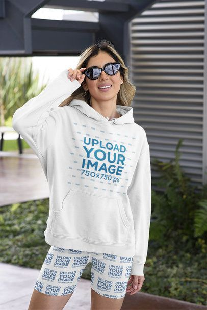 Hoodie Mockup of a Stylish Woman Wearing Bike Shorts 42378