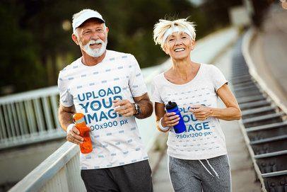 T-Shirt Mockup of a Senior Man and a Woman Running on a Sidewalk 41013-r-el2