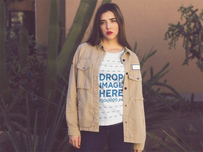 Young Woman with Red Lipstick Wearing a Round Neck Tshirt and a Light Brown Jacket While Standing near a Cactus Template a13545