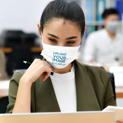 Face Mask Mockup of a Woman Focused at Work 41993-r-el2