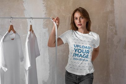Tee Mockup of a Woman Standing Next to a Rack with T-Shirts 4975-el1