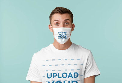 Mockup of a Young Man Wearing a T-Shirt and a Face Mask in a Studio 42853-r-el2