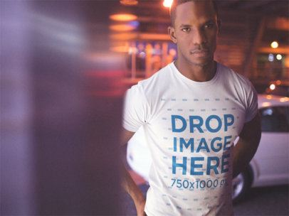 Serious Man Wearing a Round Neck Tshirt While Standing in the City at Night Template a14233