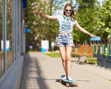 Mockup of a Woman on a Skateboard Wearing a Knotted T-Shirt 42155-r-el2