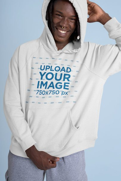 Pullover Hoodie Mockup of Man with Piercings in a Studio 42984