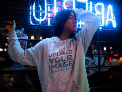 Template of an Asian Woman Wearing a Pullover Hoodie While near a Neon Light Inside a Small Diner Restaurant a12716