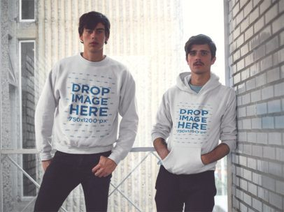 Mockup of Two Friends Wearing a Pullover Hoodie and a Crewneck Sweatshirt with Matching Colors and Designs a13416