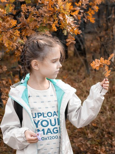 T-Shirt Mockup Featuring a Girl Holding Autumn Leaves 42461-r-el2