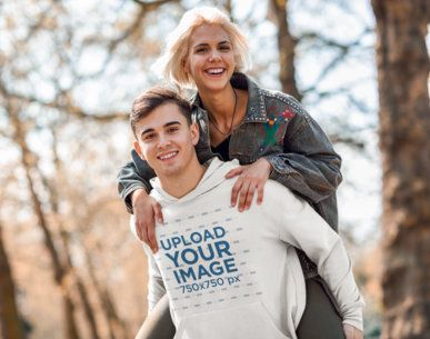 Mockup of a Young Man with a Pullover Hoodie Posing with His Girlfriend in the Woods 42240-r-el2