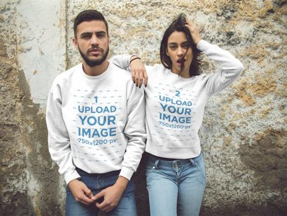 Beautiful Couple Wearing Crewneck Sweatshirts While Lying Against an Old Corner Mockup a13434