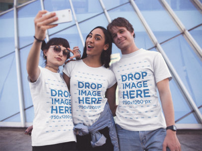 Two Girls and One Guy Wearing Same T-Shirts Taking a Selfie While Hanging out in the City a13394