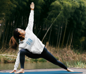 Hoodie Mockup of a Woman Doing Yoga in a Relaxing Nature Spot 40811-r-el2